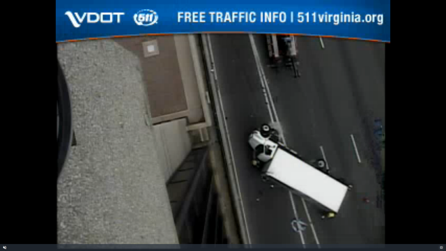 Driver charged after overturned box truck closes lanes of I-95 South near Maury Street